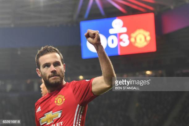 Manchester United's Spanish midfielder Juan Mata celebrates after scoring their third goal during the English Premier League football match between...