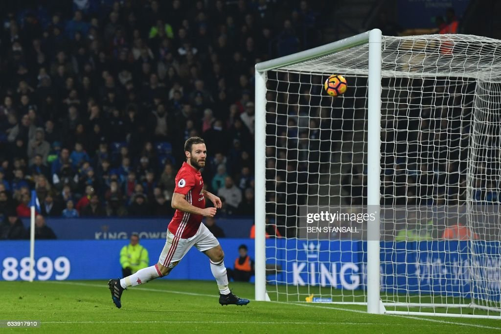 Manchester United's Spanish midfielder Juan Mata celebrates after scoring their third goal during the English Premier League football match between Leicester City and Manchester United at King Power Stadium in Leicester, central England on February 5, 2017. / AFP / Ben STANSALL / RESTRICTED TO EDITORIAL USE. No use with unauthorized audio, video, data, fixture lists, club/league logos or 'live' services. Online in-match use limited to 75 images, no video emulation. No use in betting, games or single club/league/player publications. /