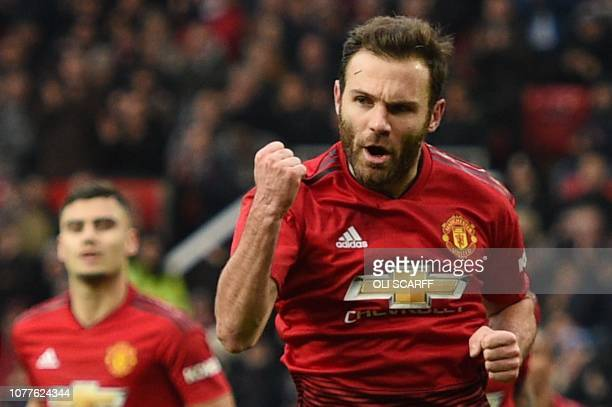 Manchester United's Spanish midfielder Juan Mata celebrates scoring the opening goal during the English FA Cup third round football match between...