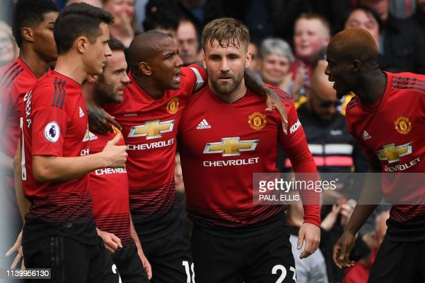 Manchester United's Spanish midfielder Juan Mata celebrates scoring the opening goal during the English Premier League football match between...