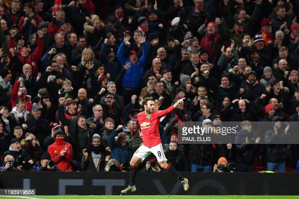 Manchester United's Spanish midfielder Juan Mata celebrates scoring the opening goal during the English FA Cup third roundreplay football match...