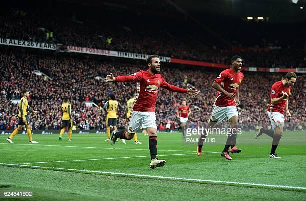 Manchester United's Spanish midfielder Juan Mata celebrates scoring his team's first goal during the English Premier League football match between...