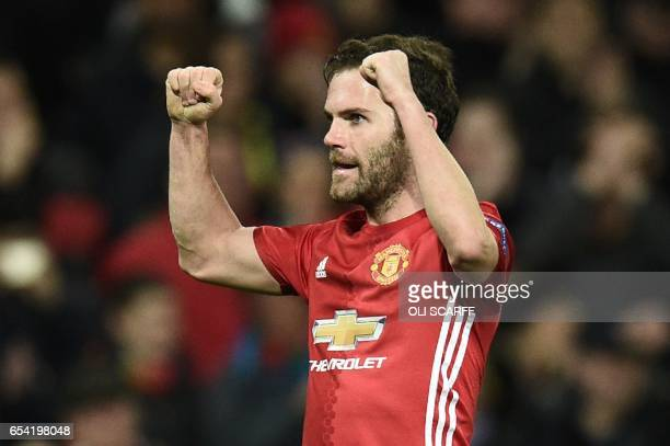 Manchester United's Spanish midfielder Juan Mata celebrates scoring the opening goal during the UEFA Europa League round of 16 second-leg football...