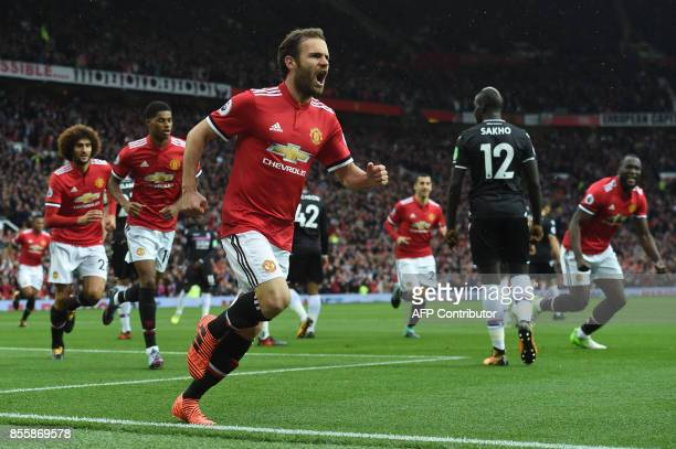 Manchester United's Spanish midfielder Juan Mata celebrates scoring the team's first goal during the English Premier League football match between...