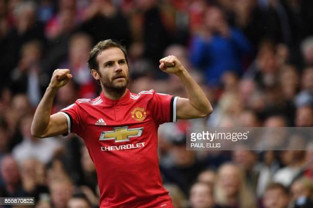 Manchester United's Spanish midfielder Juan Mata celebrates scoring the team's first goal during the English Premier League football match between...