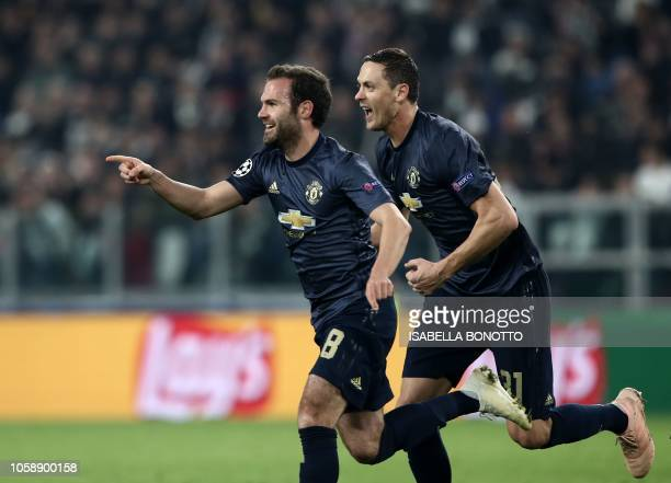 Manchester United's Spanish midfielder Juan Mata celebrates with Manchester United's Serbian midfielder Nemanja Matic after scoring a free kick...