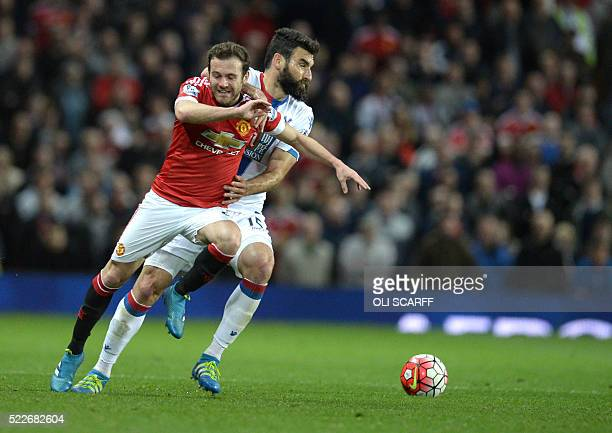 Manchester United's Spanish midfielder Juan Mata is fouled by Crystal Palace's Australian midfielder Mile Jedinak during the English Premier League...