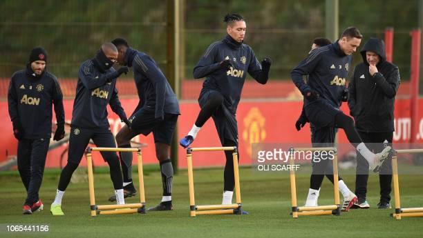 Manchester United's Spanish midfielder Juan Mata Manchester United's English midfielder Ashley Young Manchester United's French midfielder Paul Pogba...