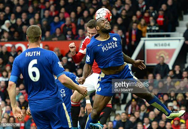 Manchester United's Spanish midfielder Juan Mata rises up against Leicester City's English defender Wes Morgan for a header during the English...
