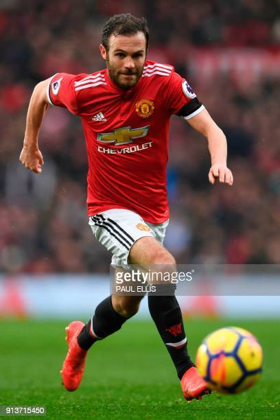 Manchester United's Spanish midfielder Juan Mata runs with the ball during the English Premier League football match between Manchester United and...