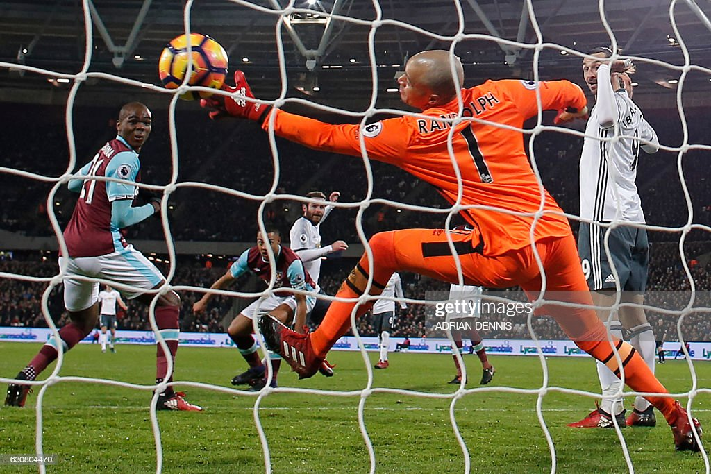 TOPSHOT - Manchester United's Spanish midfielder Juan Mata (C) scores the opening goal past West Ham United's Irish goalkeeper Darren Randolph during the English Premier League football match between West Ham United and Manchester United at The London Stadium, in east London on January 2, 2017. Manchester United won the game 2-0. / AFP / Adrian DENNIS / RESTRICTED TO EDITORIAL USE. No use with unauthorized audio, video, data, fixture lists, club/league logos or 'live' services. Online in-match use limited to 75 images, no video emulation. No use in betting, games or single club/league/player publications. /
