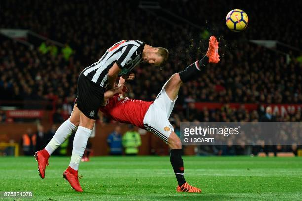 TOPSHOT Manchester United's Spanish midfielder Juan Mata tries an overhead kick as Newcastle United's French midfiielder Florian Lejeune goes for a...