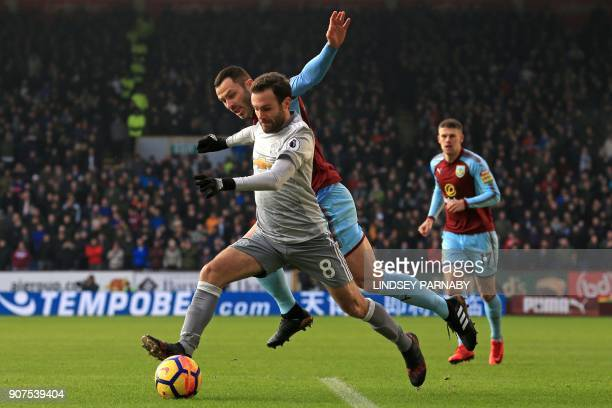 Manchester United's Spanish midfielder Juan Mata vies with Burnley's Englishborn Scottish defender Phil Bardsley during the English Premier League...