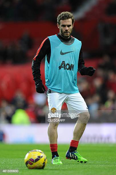 Manchester United's Spanish midfielder Juan Mata warms up ahead of the English Premier League football match between Manchester United and...