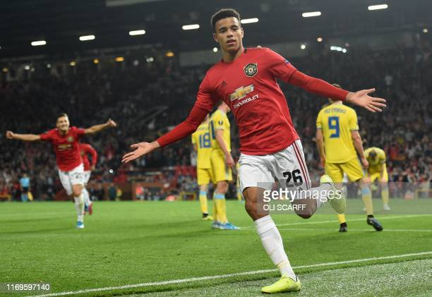 Manchester United's striker Mason Greenwood celebrates after scoring the opening goal of the UEFA Europa League Group L football match between...