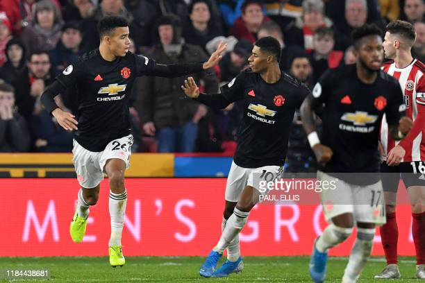 Manchester United's striker Mason Greenwood celebrates with Manchester United's English striker Marcus Rashford after scoring their second goal...