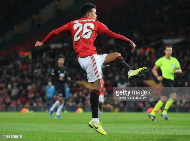 Manchester United's striker Mason Greenwood scores their fourth goal during the UEFA Europa League group L football match between Manchester United...