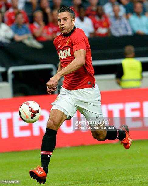 Manchester United's striker Robin Van Persie controls the ball during a friendly football match between AIK and Manchester United on August 6 2013 at...