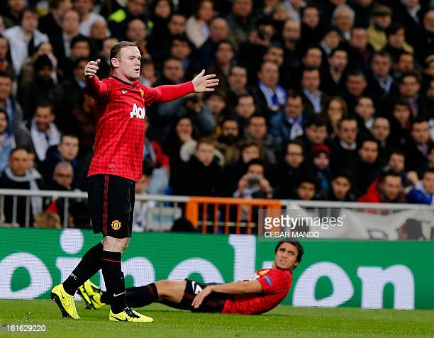 Manchester United's striker Wayne Rooney reacts during the UEFA Champions League round of 16 first leg football match Real Madrid CF vs Manchester...