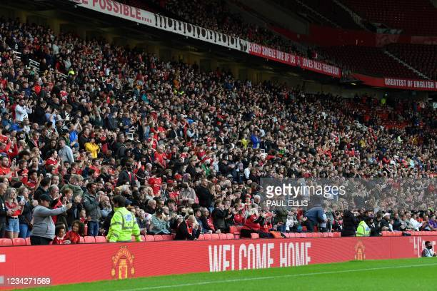 Manchester United's supporters wait for the start of the English Premier League pre-season friendly football match between Manchester United and...