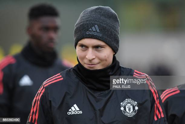 Manchester United's Swedish defender Victor Lindelof attneds a team training session at the club's training complex near Carrington west of...