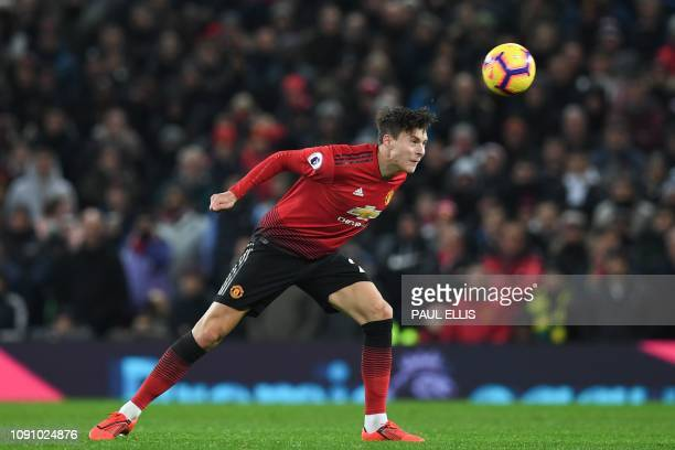 TOPSHOT Manchester United's Swedish defender Victor Lindelof heads the ball during the English Premier League football match between Manchester...