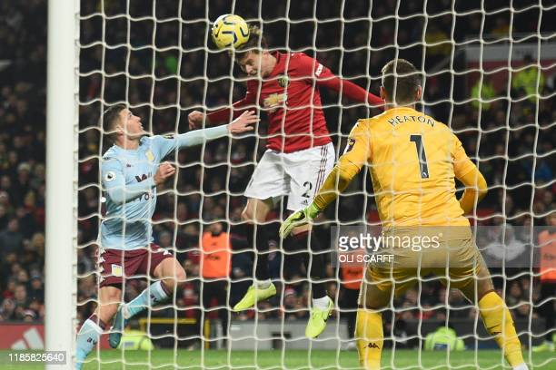 Manchester United's Swedish defender Victor Lindelof heads their second goal during the English Premier League football match between Manchester...