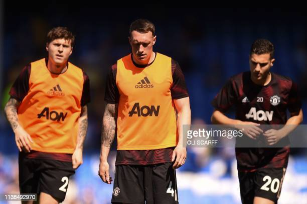 Manchester United's Swedish defender Victor Lindelof , Manchester United's English defender Phil Jones and Manchester United's Portuguese defender...