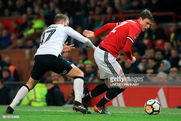 Manchester United's Swedish defender Victor Lindelof turns Derby's English midfielder Sam Winnall during the English FA Cup third round football...