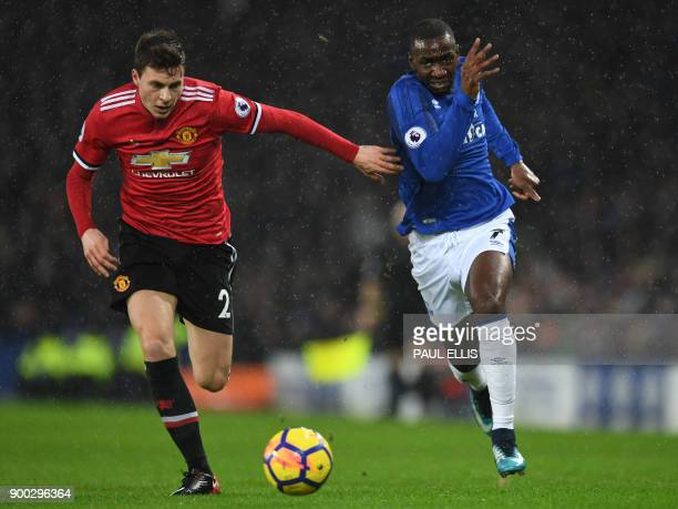 Manchester United's Swedish defender Victor Lindelof vies with Everton's French striker Yannick Bolasie during the English Premier League football...