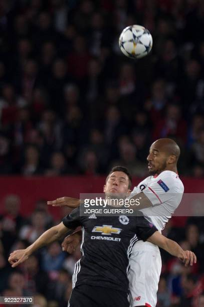 Manchester United's Swedish defender Victor Lindelof vies with Sevilla's French midfielder Steven N'Zonzi during the UEFA Champions League round of...