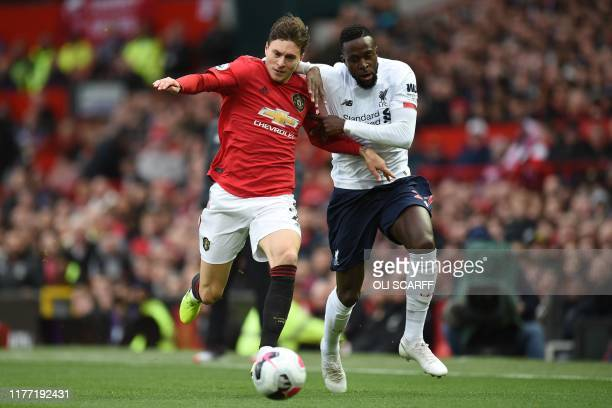 TOPSHOT Manchester United's Swedish defender Victor Lindelof vies with Liverpool's Belgium striker Divock Origi during the English Premier League...