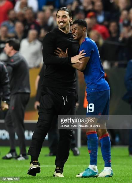 Manchester United's Swedish striker Zlatan Ibrahimovic and Manchester United's English striker Marcus Rashford celebrate after the UEFA Europa League...