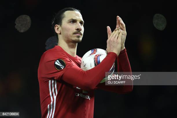 TOPSHOT Manchester United's Swedish striker Zlatan Ibrahimovic applauds the fans following the UEFA Europa League Round of 32 firstleg football match...