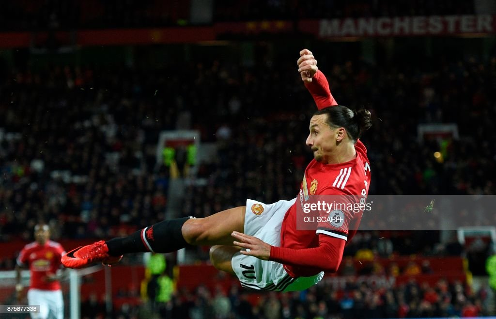 TOPSHOT - Manchester United's Swedish striker Zlatan Ibrahimovic attempts a bicycle kick shot which was saved during the English Premier League football match between Manchester United and Newcastle at Old Trafford in Manchester, north west England, on November 18, 2017. / AFP PHOTO / Oli SCARFF / RESTRICTED TO EDITORIAL USE. No use with unauthorized audio, video, data, fixture lists, club/league logos or 'live' services. Online in-match use limited to 75 images, no video emulation. No use in betting, games or single club/league/player publications. /