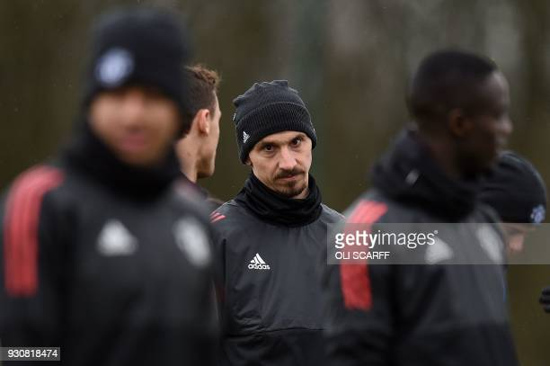 Manchester United's Swedish striker Zlatan Ibrahimovic attends a team training session at the club's training complex near Carrington west of...