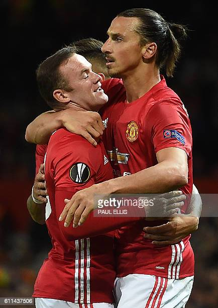 Manchester United's Swedish striker Zlatan Ibrahimovic celebrates scoring his team's first goal with Manchester United's English striker Wayne Rooney...
