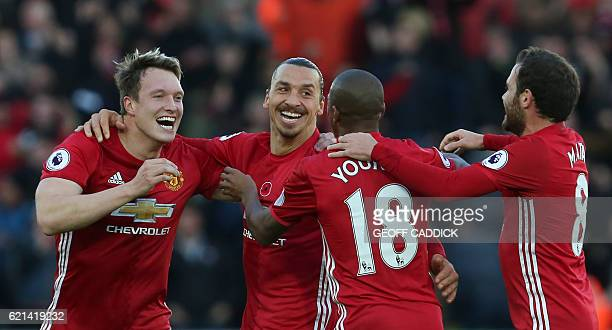 Manchester United's Swedish striker Zlatan Ibrahimovic celebrates scoring his team's second goal with Manchester United's English defender Phil Jones...