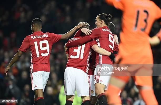 Manchester United's Swedish striker Zlatan Ibrahimovic celebrates scoring his team's fourth goal with Manchester United's English striker Marcus...