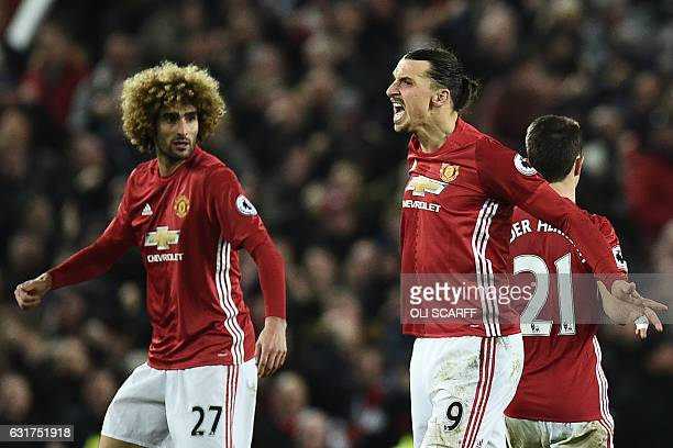 Manchester United's Swedish striker Zlatan Ibrahimovic celebrates scoring his team's first goal with Manchester United's Belgian midfielder Marouane...