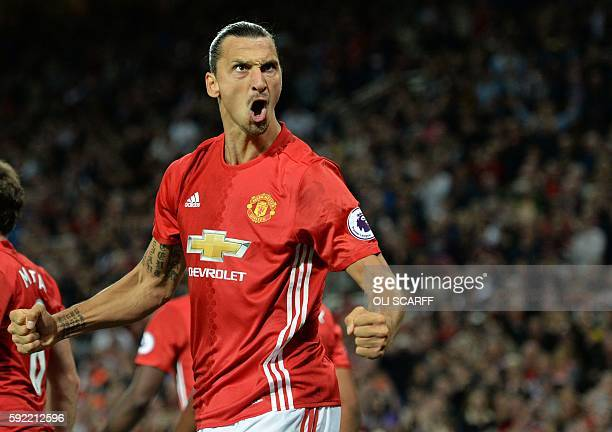 Manchester United's Swedish striker Zlatan Ibrahimovic celebrates after scoring their second goal from the penalty spot during the English Premier...