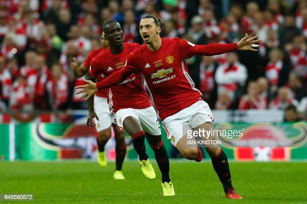 Manchester United's Swedish striker Zlatan Ibrahimovic celebrates scoring the opening goal during the English League Cup final football match between...