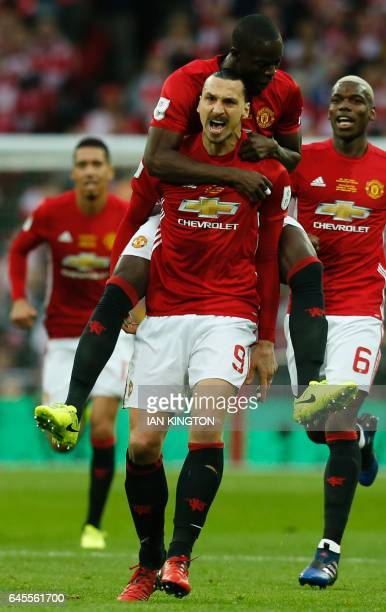 Manchester United's Swedish striker Zlatan Ibrahimovic celebrates scoring the opening goal with Manchester United's Ivorian defender Eric Bailly and...