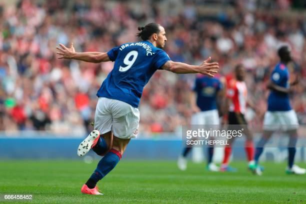 Manchester United's Swedish striker Zlatan Ibrahimovic celebrates scoring the opening goal during the English Premier League football match between...