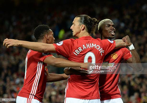 Manchester United's Swedish striker Zlatan Ibrahimovic celebrates with Manchester United's French midfielder Paul Pogba and Manchester United's...