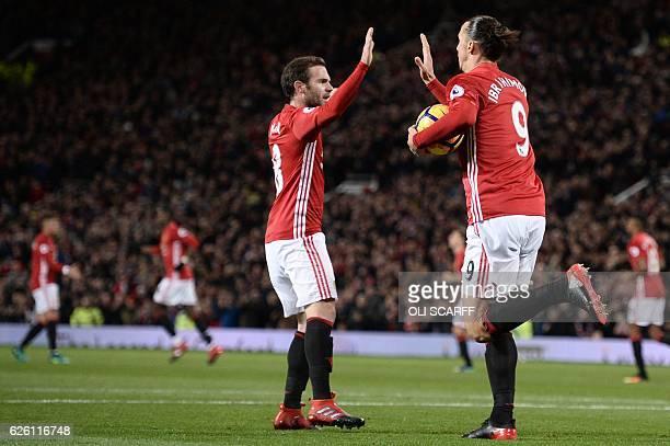 Manchester United's Swedish striker Zlatan Ibrahimovic celebrates with Manchester United's Spanish midfielder Juan Mata after Ibrahimovic scored...