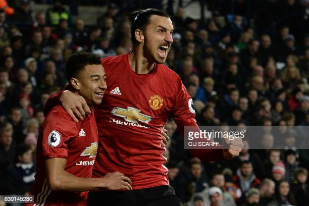 Manchester United's Swedish striker Zlatan Ibrahimovic celebrates with Manchester United's English midfielder Jesse Lingard after scoring the opening...