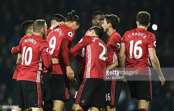 Manchester United's Swedish striker Zlatan Ibrahimovic celebrates with teammates after scoring their second goal during the English Premier League...