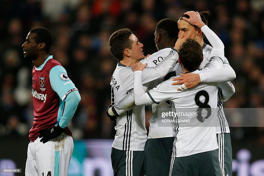 Manchester United's Swedish striker Zlatan Ibrahimovic (R) celebrates with teammates after scoring their second goal during the English Premier League football match between West Ham United and Manchester United at The London Stadium, in east London on January 2, 2017. / AFP / Adrian DENNIS / RESTRICTED TO EDITORIAL USE. No use with unauthorized audio, video, data, fixture lists, club/league logos or 'live' services. Online in-match use limited to 75 images, no video emulation. No use in betting, games or single club/league/player publications. /