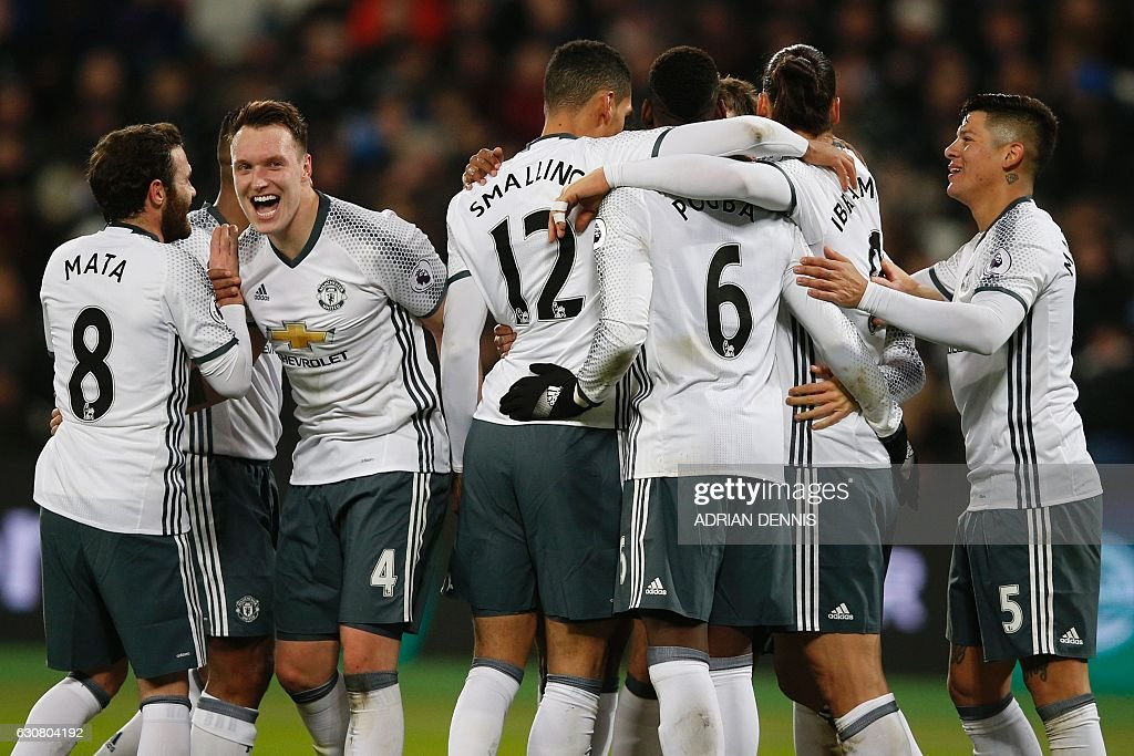 Manchester United's Swedish striker Zlatan Ibrahimovic (2nd R) celebrates with teammates after scoring their second goal during the English Premier League football match between West Ham United and Manchester United at The London Stadium, in east London on January 2, 2017. Manchester United won the game 2-0. / AFP / Adrian DENNIS / RESTRICTED TO EDITORIAL USE. No use with unauthorized audio, video, data, fixture lists, club/league logos or 'live' services. Online in-match use limited to 75 images, no video emulation. No use in betting, games or single club/league/player publications. /